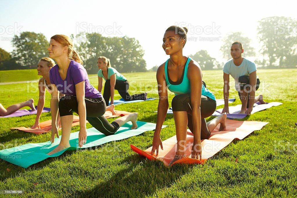 Keeping tight bodies - Yoga royalty-free stock photo