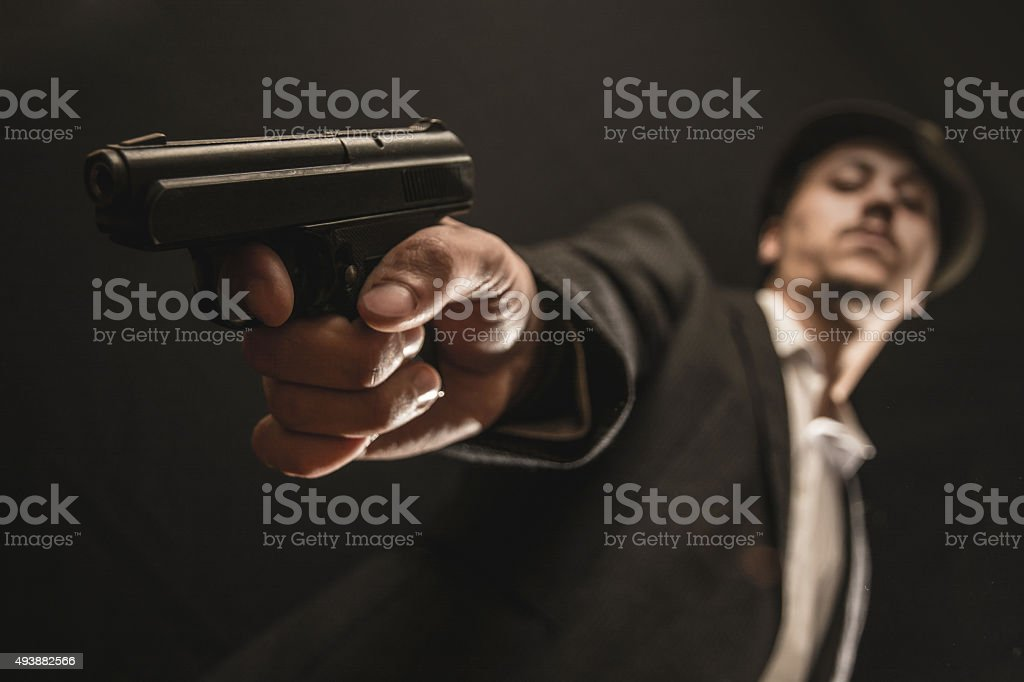 keeps a weapon the gangster stock photo