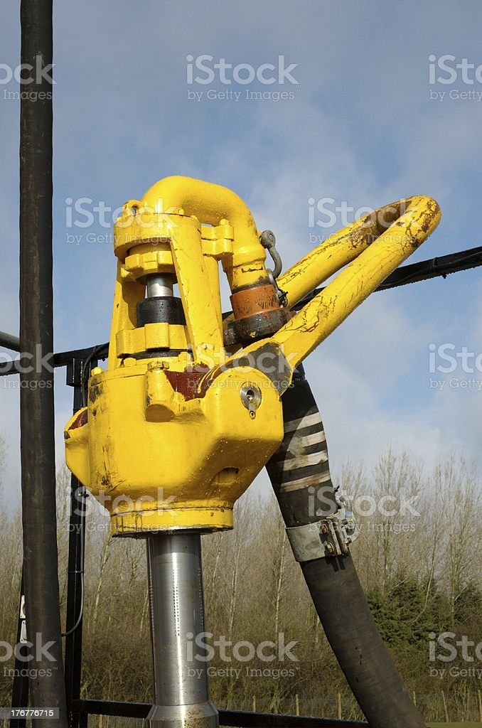 Kelly hose, goose neck, svivel, bail and kelly on an oil rig stock photo