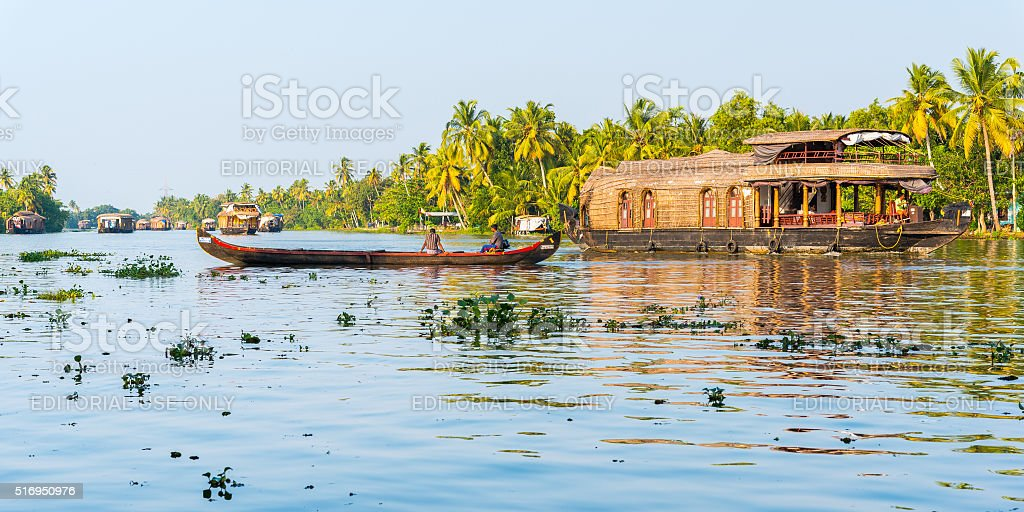 Kerala Backwaters with a canoe and houseboat stock photo