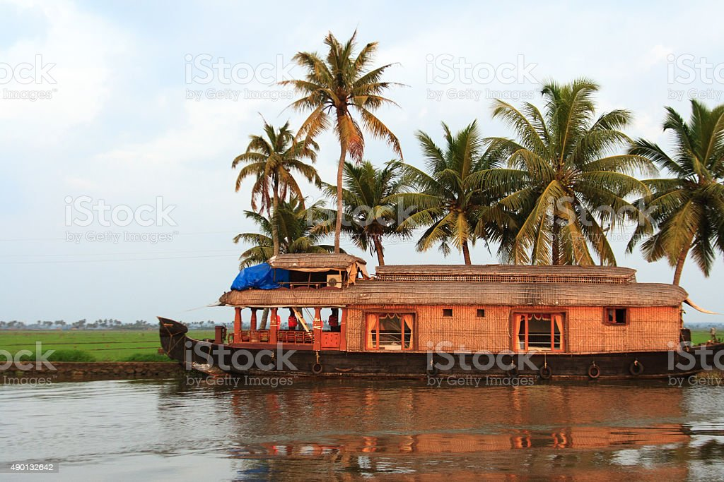 Kerala, India: Backwater Lagoon with Palms and Traditional Barge stock photo