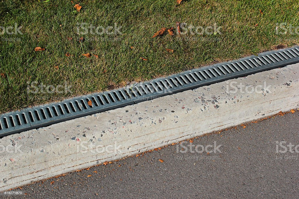 Kerbside and rainwater drainage system in a park stock photo