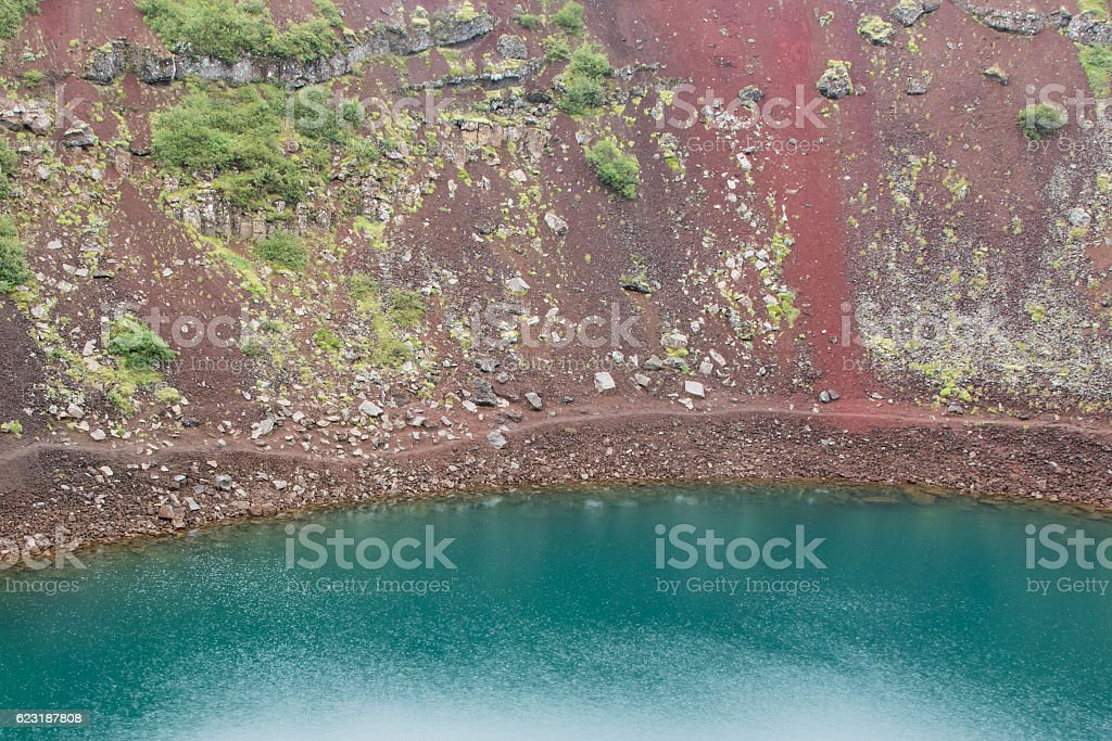 Kerid is a crater lake of a turquoise color stock photo