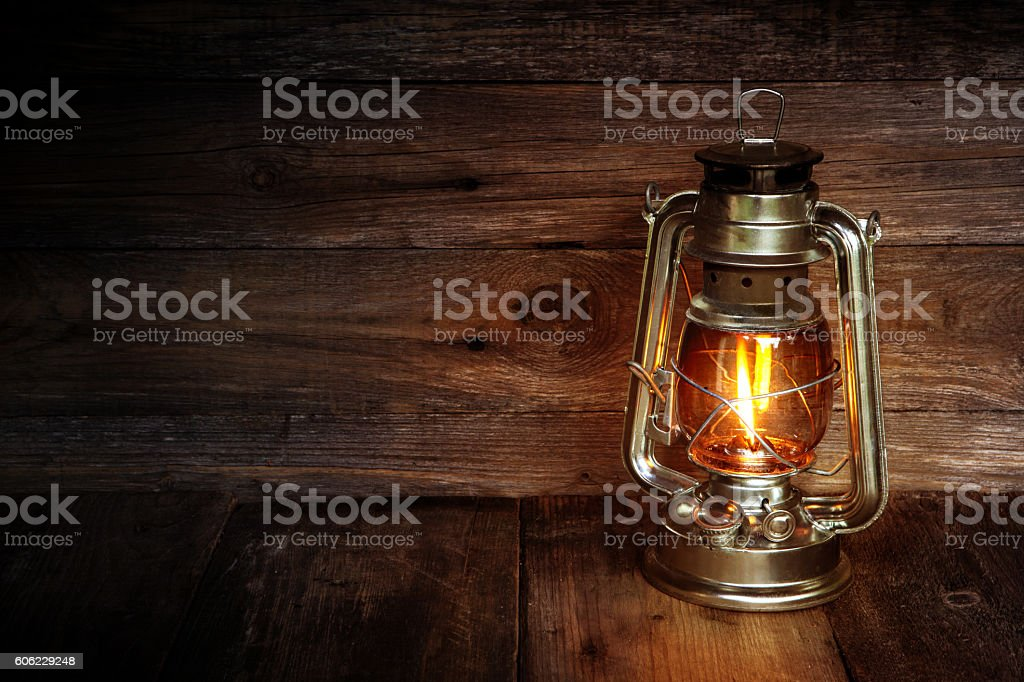 Kerosene lamp on a wooden background stock photo