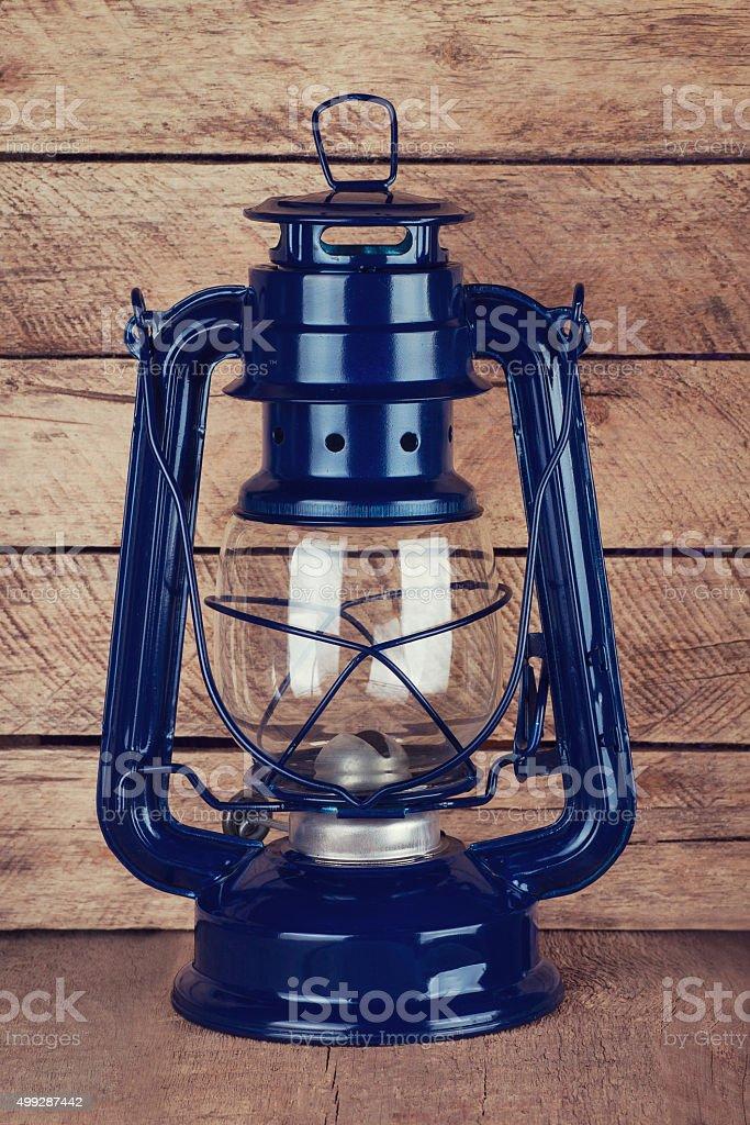 kerosene lamp on wooden table stock photo