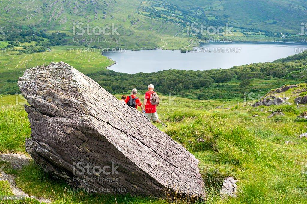 kerry way big rock with hikers stock photo