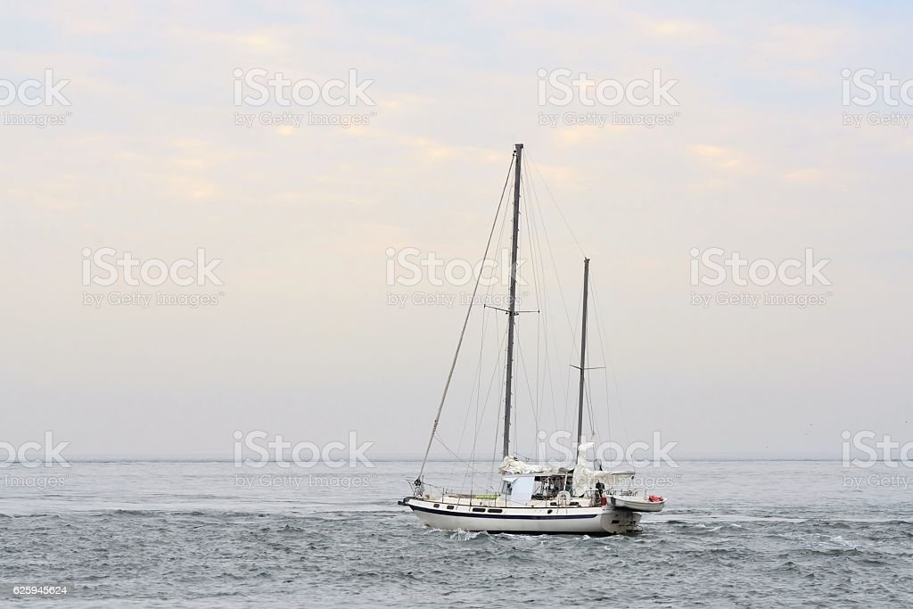 Ketch Sailboat Setting Out to Sea stock photo