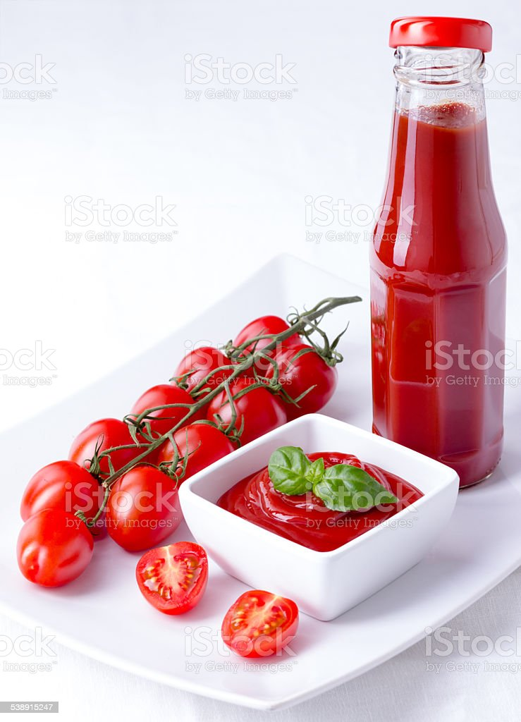 Ketchup, catsup in a bottle and a bowl, copy space stock photo