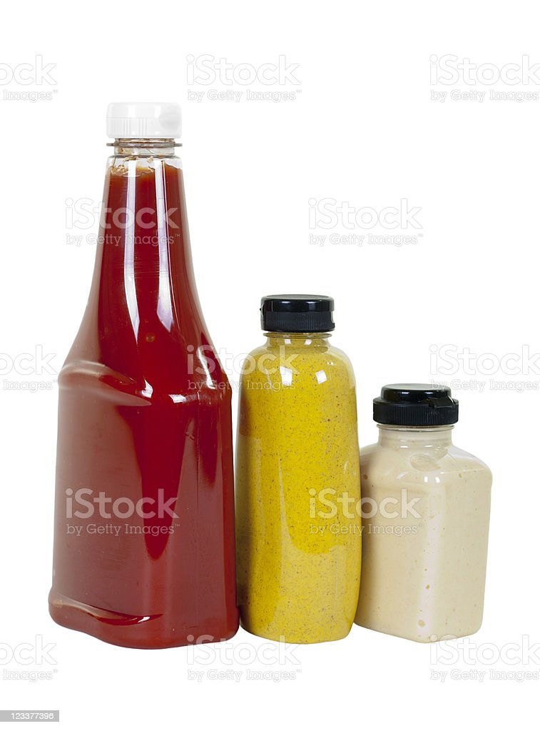 Ketchup, Mustard and Horseradish in Bottles; Angle View stock photo