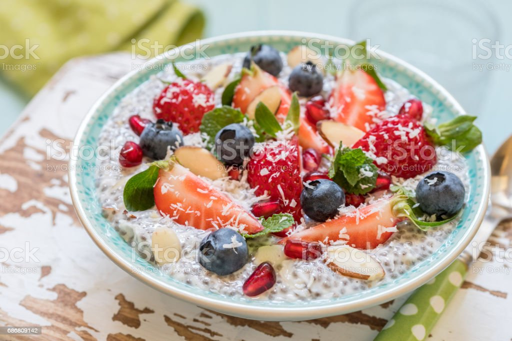 Keto ketogenic, paleo low carb diet not oatmeal breakfast porridge. Coconut Chia Pudding with berries, pomegranate seeds and almond stock photo