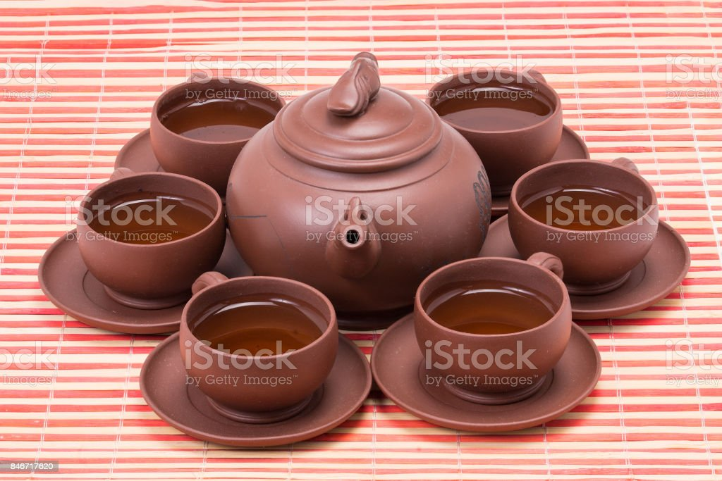kettle and Cup of tea claay stock photo