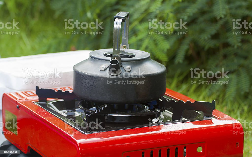 Kettle and Gas stove royalty-free stock photo
