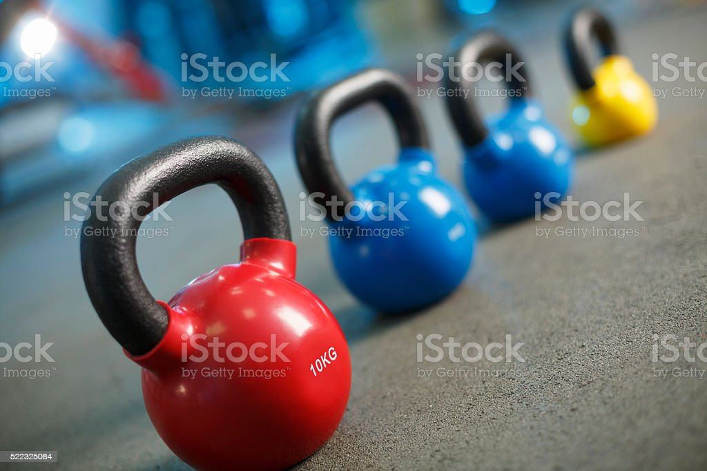 Kettle bell at the gym   Fitness   Sports training   background stock photo