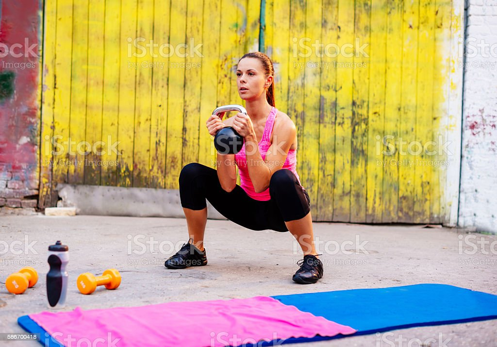 Kettle bell workout outdoors stock photo