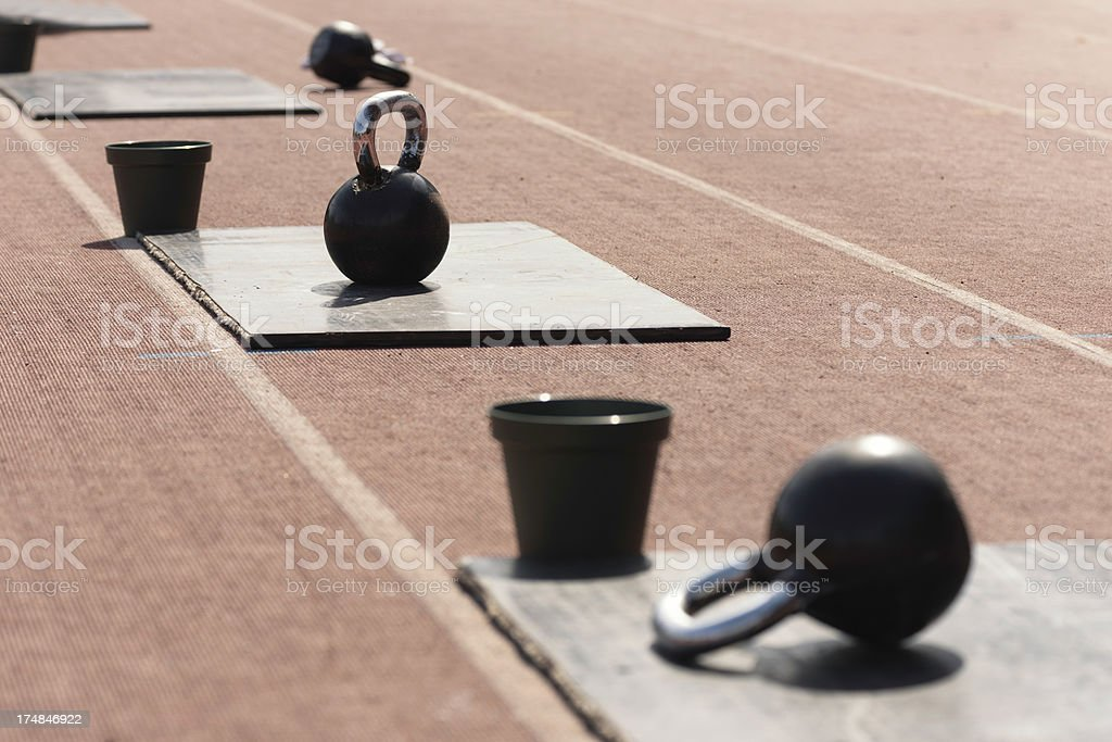 Kettle bells and chalk buckets on gym competition royalty-free stock photo