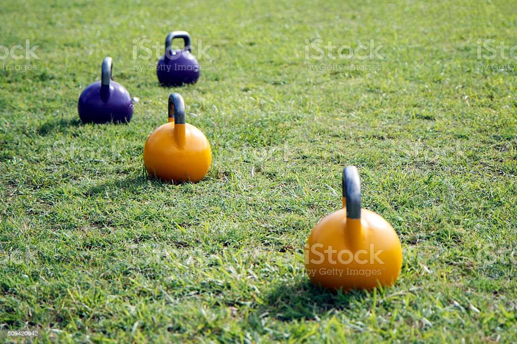 Kettle bells on grass stock photo
