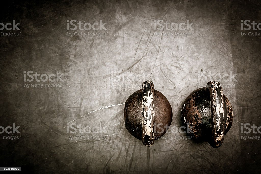 Kettle bells on the floor stock photo