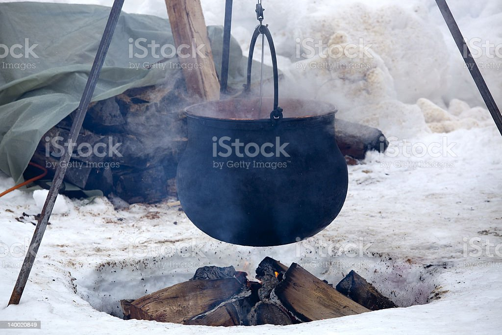 Kettle over open fire royalty-free stock photo