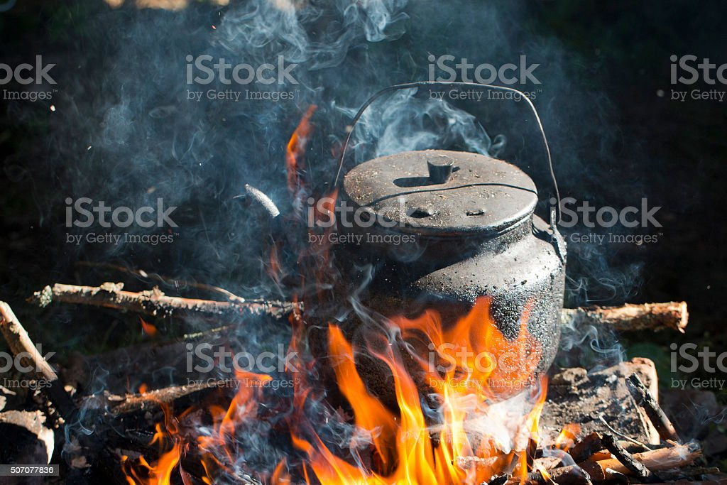 kettle put in fire place stock photo