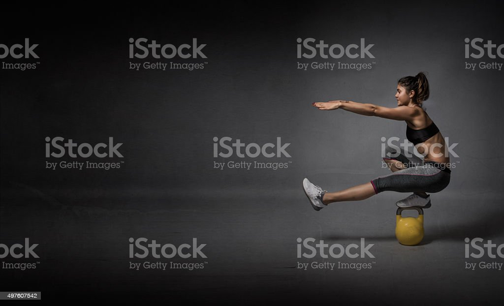kettlebell balance demonstration stock photo