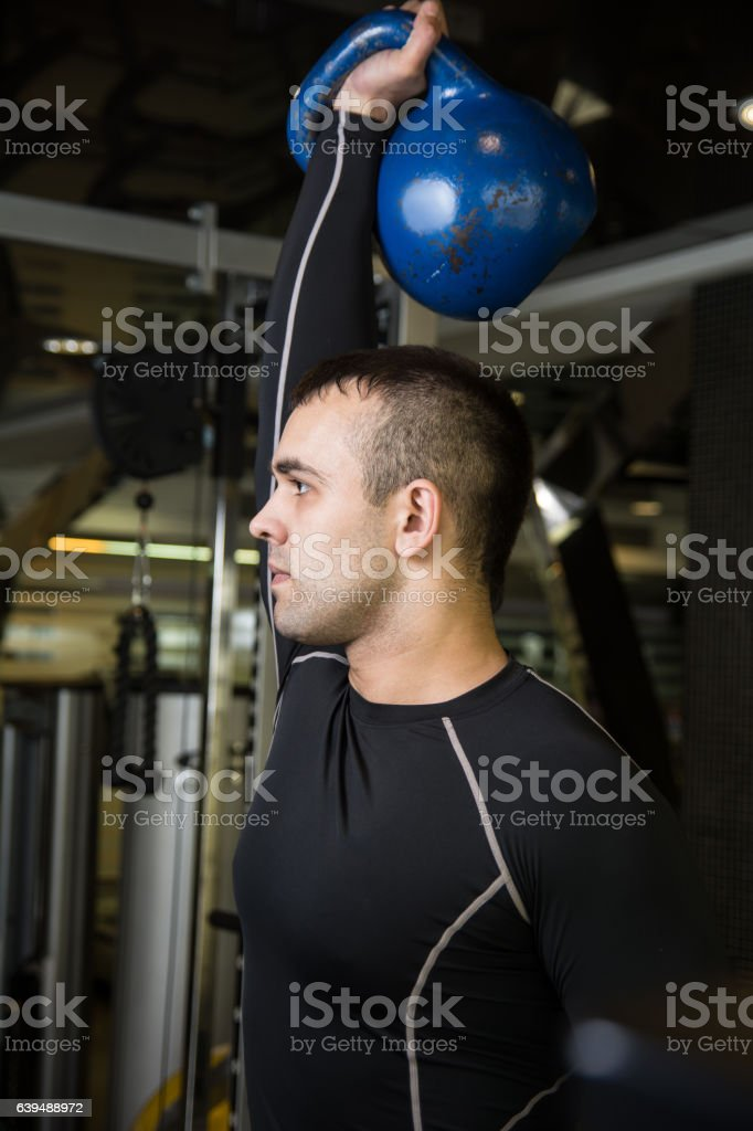 Kettlebell swing workout training man at gym stock photo