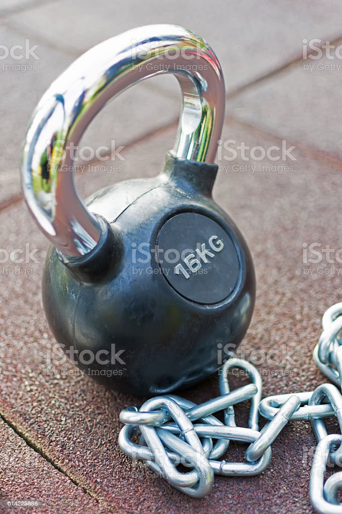 Kettlebell With Handle and Chains Background stock photo
