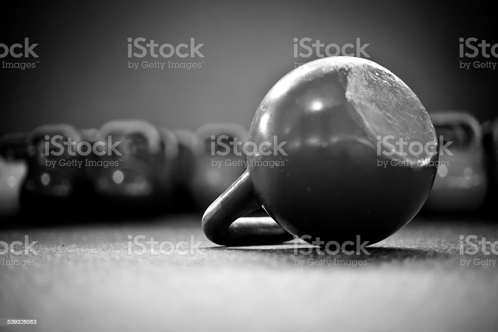 kettlebells in a gym II stock photo