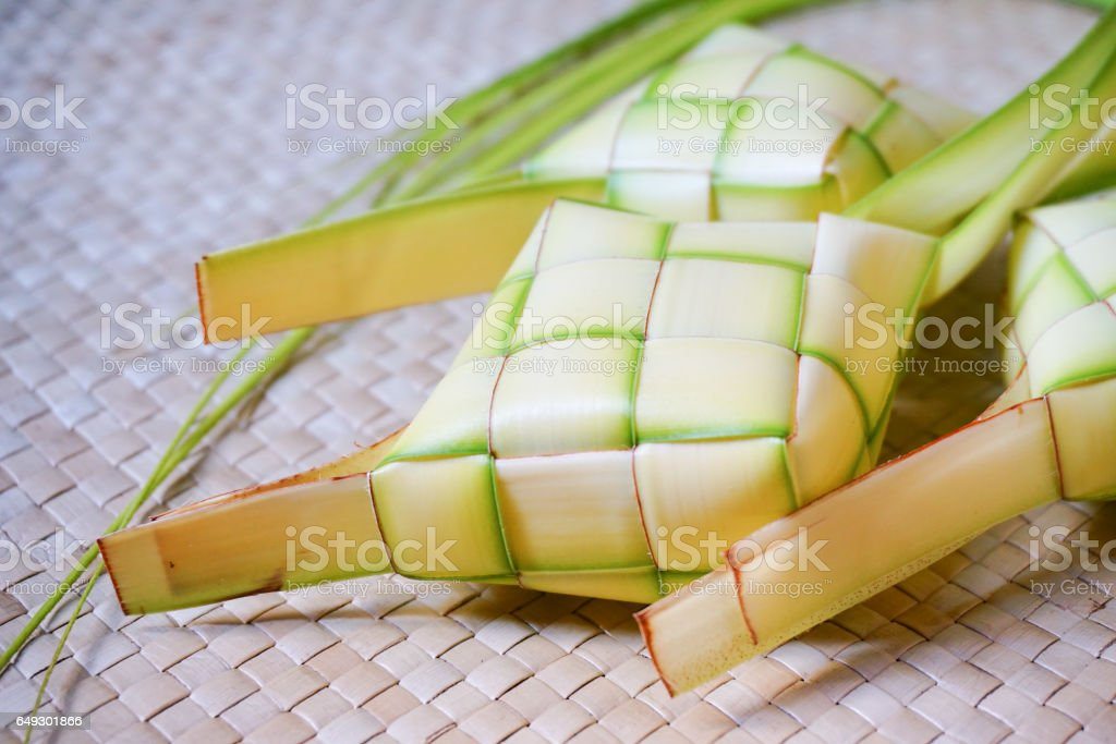 Ketupat (rice dumpling) a natural rice casing made from young coconut leaves for cooking rice. stock photo