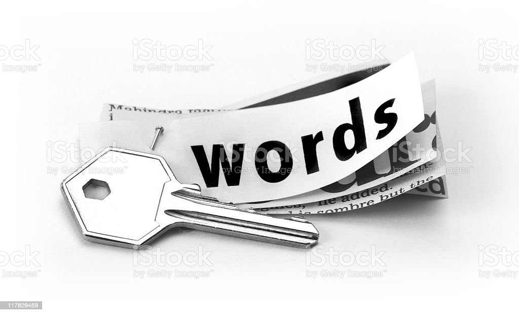 Key and printed  text words placed together to convey keywords. royalty-free stock photo
