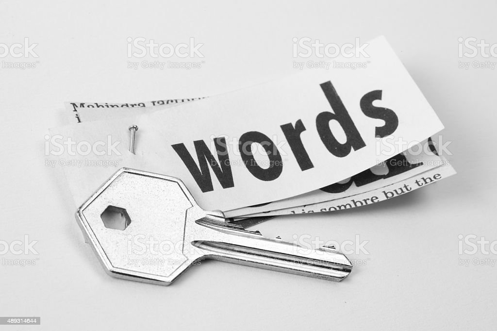 Key and printed text words placed together to convey keywords. stock photo