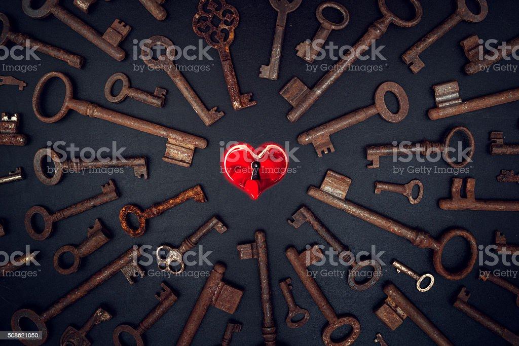 key for heart on blackboard stock photo