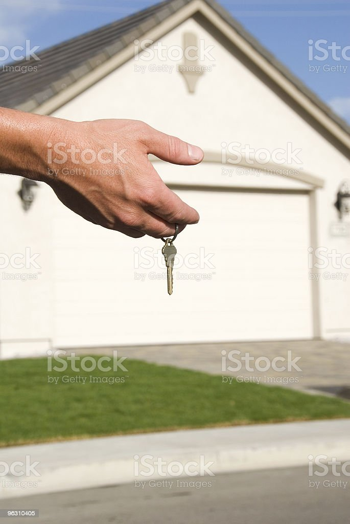 Key in front of garage royalty-free stock photo