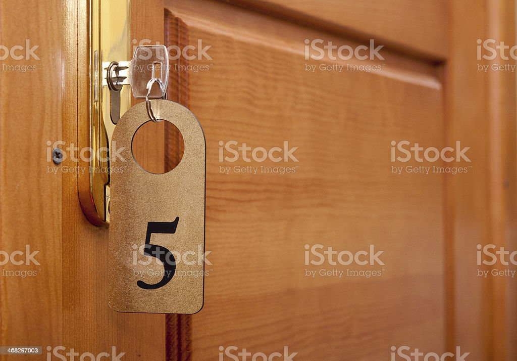 key in keyhole with numbered label stock photo