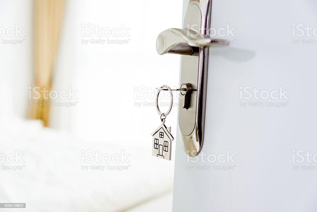 Key in open door stock photo