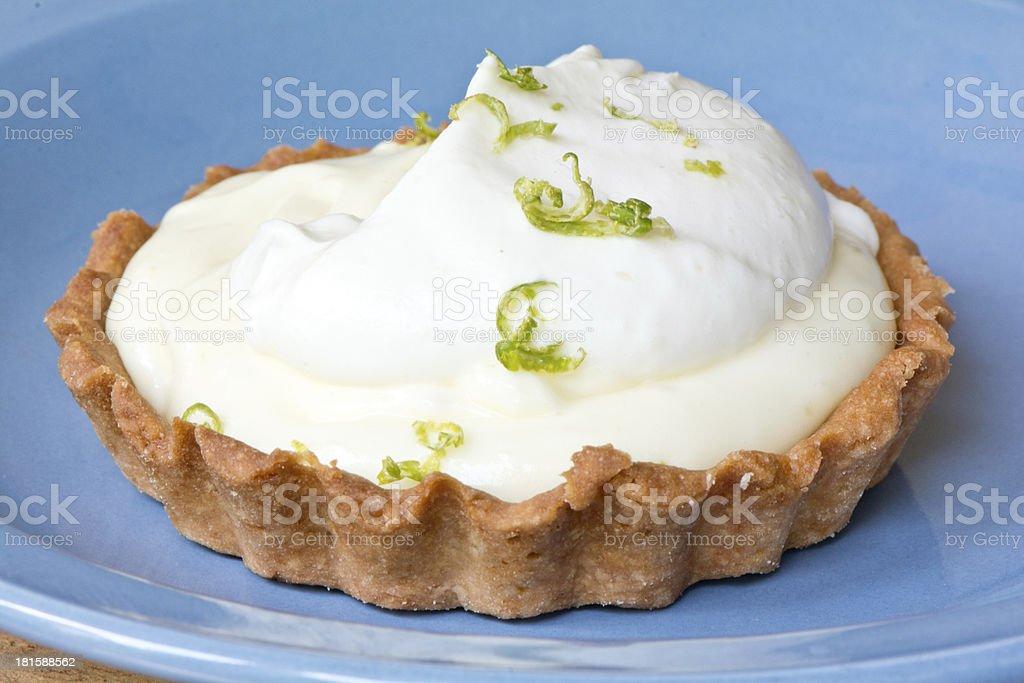 Key Lime Pie Tart on blue plate royalty-free stock photo
