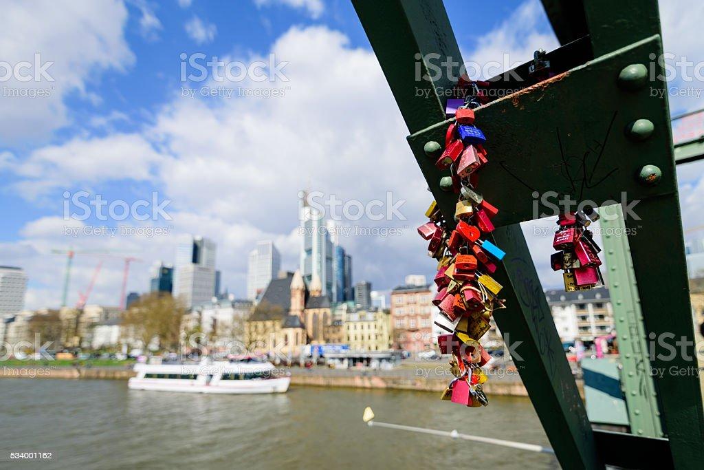 Key locks hang on bridge in frankfurt stock photo