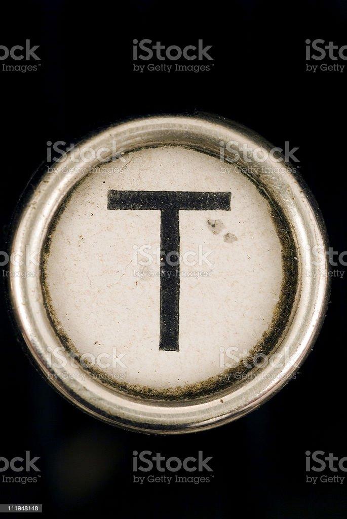 T key of a full alphabet from grungey typewriter stock photo