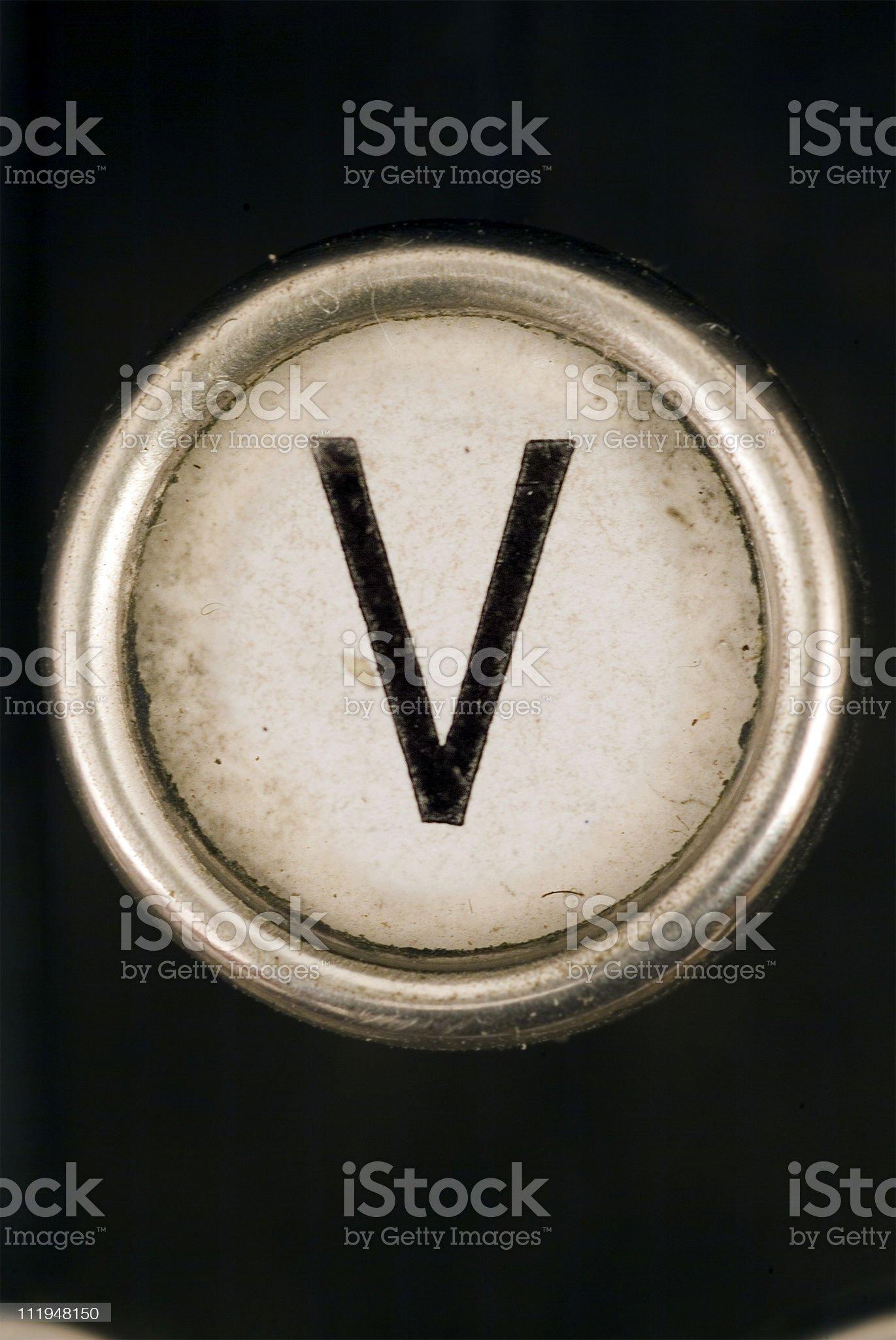 V key of a full alphabet from grungey typewriter royalty-free stock photo