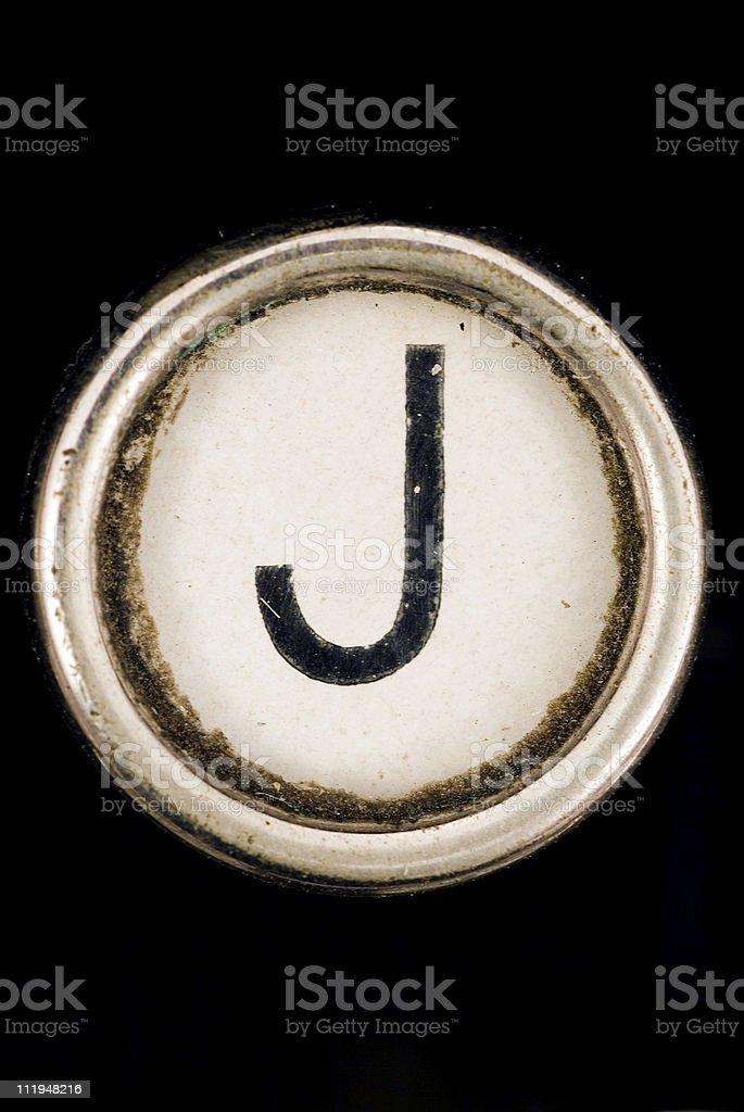 J key of a full alphabet from grungey typewriter stock photo