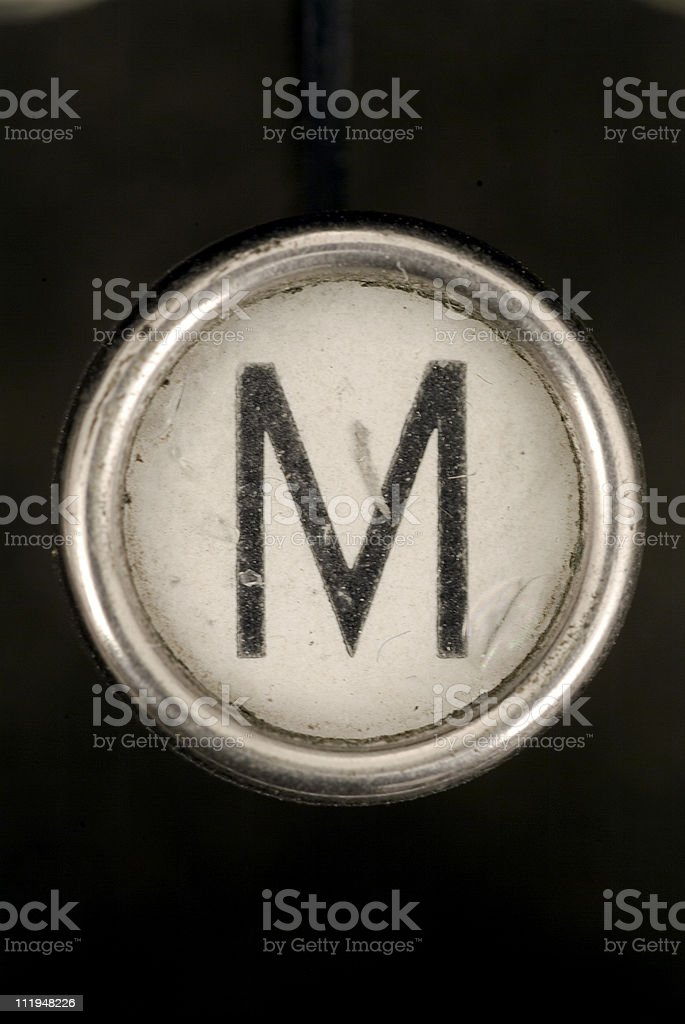 M key of a full alphabet from grungey typewriter royalty-free stock photo
