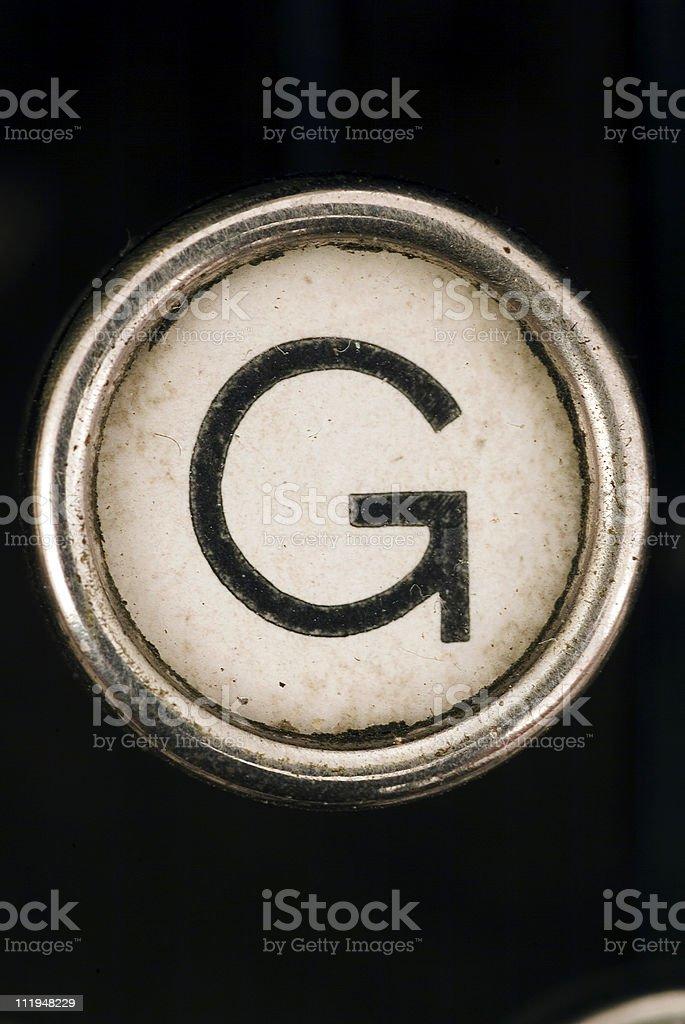 G key of a full alphabet from grungey typewriter royalty-free stock photo