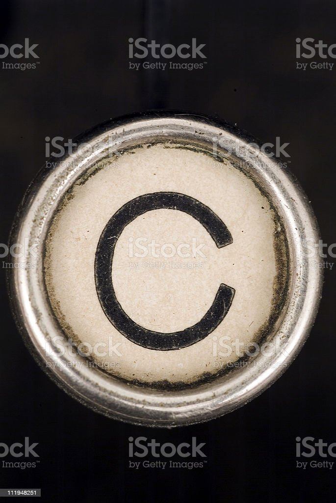 C key of a full alphabet from grungey typewriter stock photo