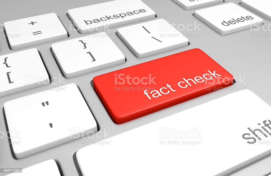 Key on a computer keyboard for fact checking statements stock photo