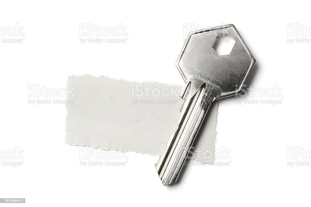 Key on Top of Torn Newspaper royalty-free stock photo