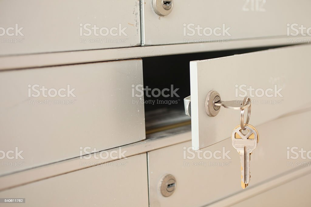 Key opening apartment mailbox. Letters inside. stock photo