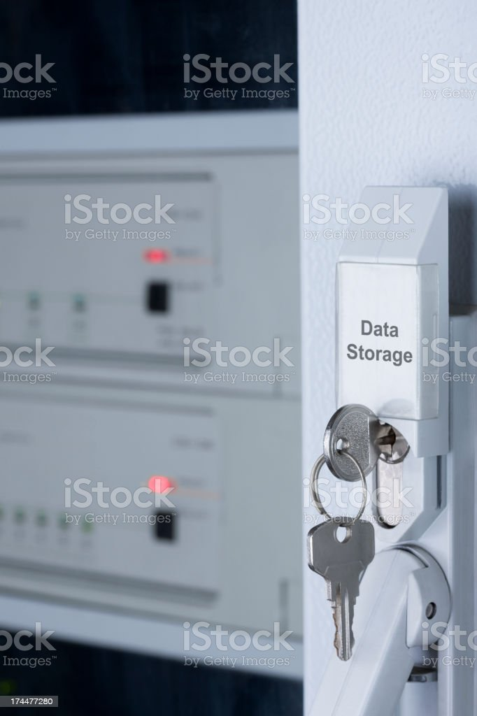 A key placed in a data protection box royalty-free stock photo