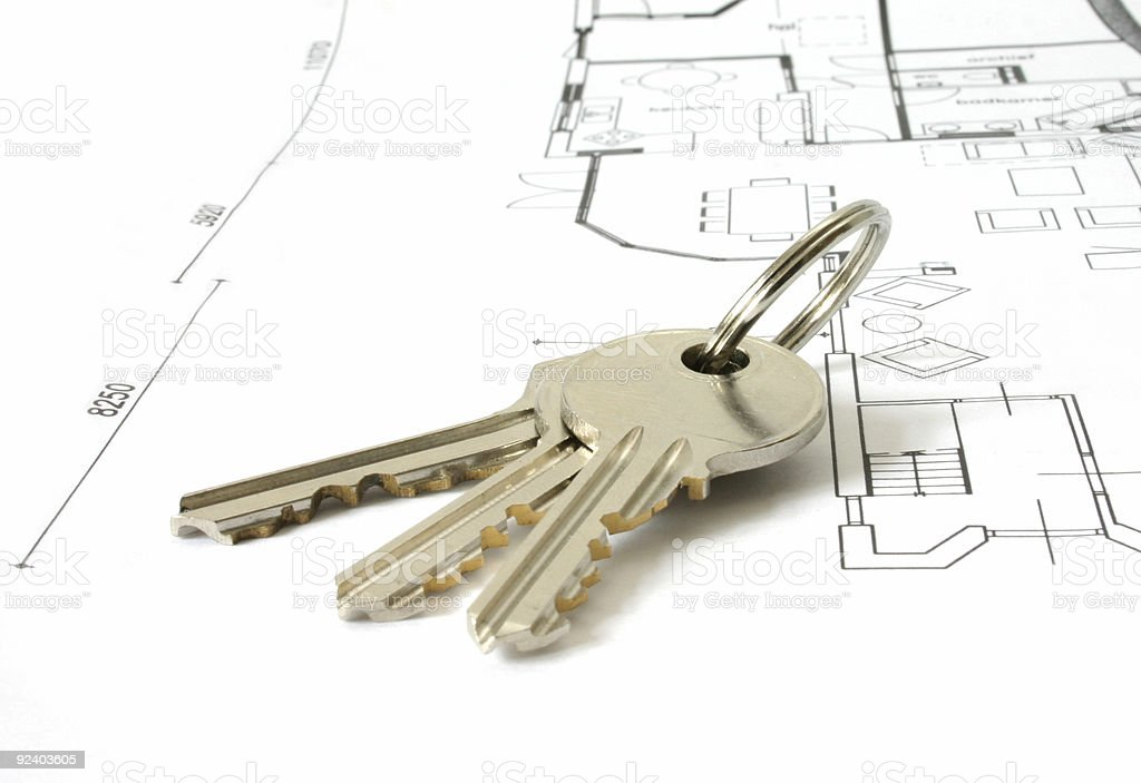 Key ring with three keys sitting on building plans  royalty-free stock photo