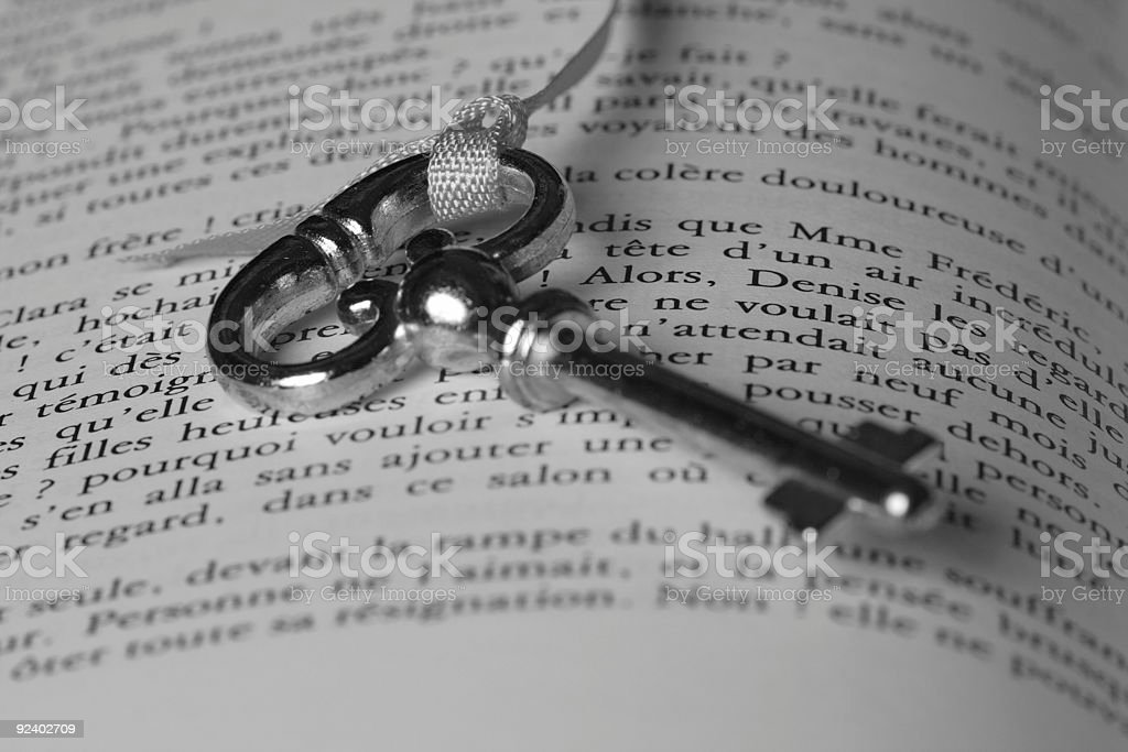 Key tied to a bookmark royalty-free stock photo