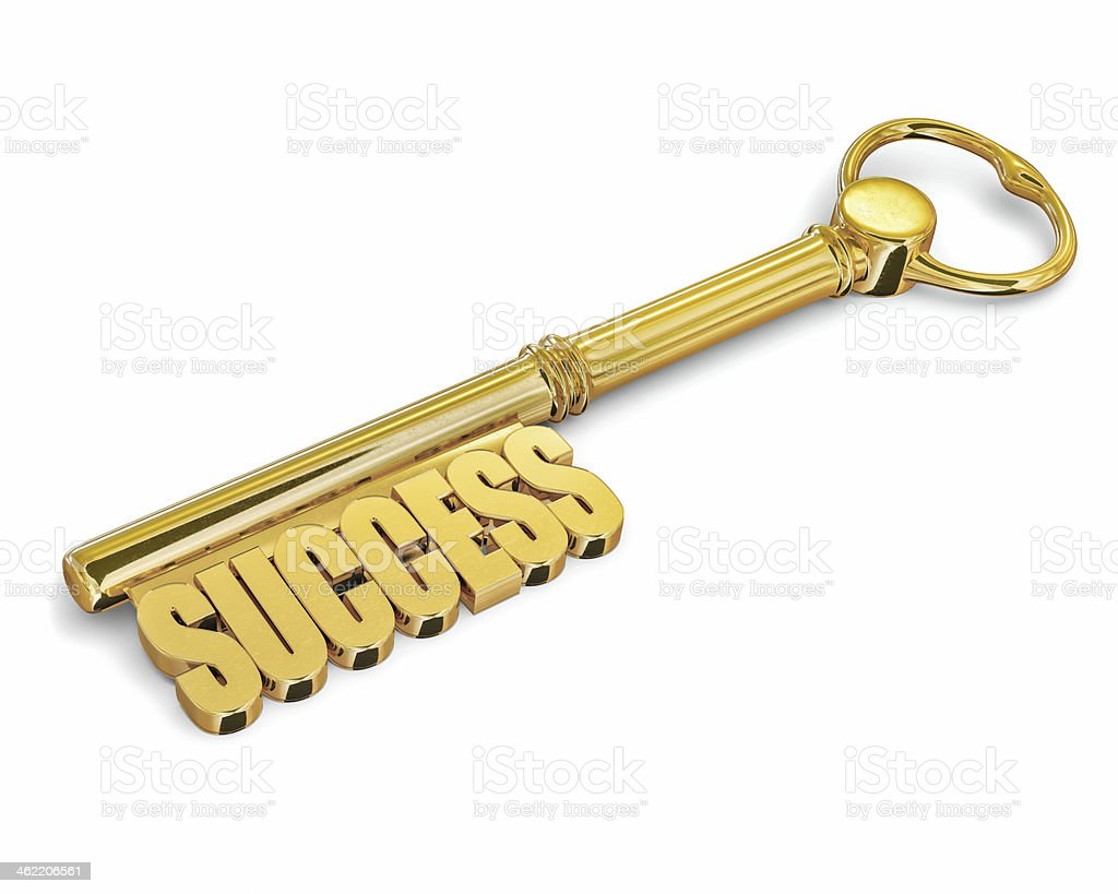 Key to success made of gold isolated stock photo