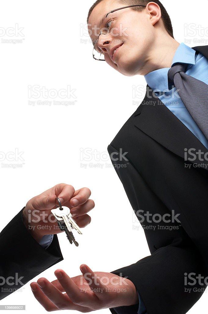 Key to success - Youg businessman receiving keys royalty-free stock photo